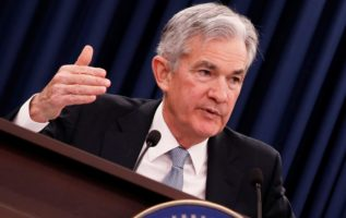 Fed points to more rate hikes amid criticism from Trump 2
